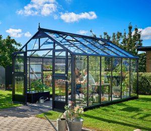 Juliana Premium Greenhouse in a garden setting.